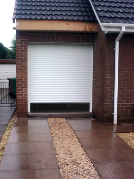 opening single roller garage door in white
