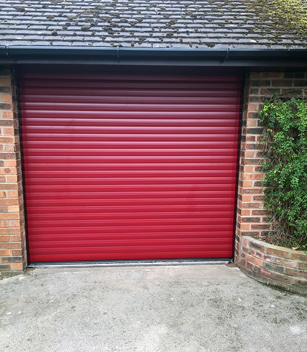 roller garage door finished in ruby red