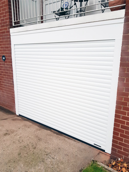 white roller garage door outdoor view
