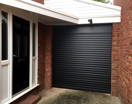 roller garage door in complimentary black finish