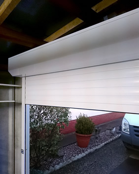 white roller garage door interior at dusk