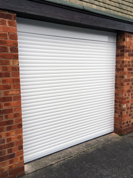 roller garage door finished in white outdoor view