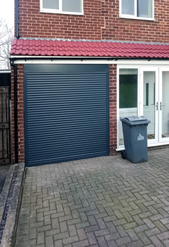 automated anthracite roller garage door in halton