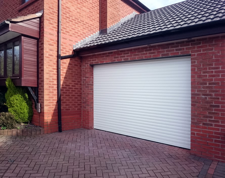 electric double roller garage door in white